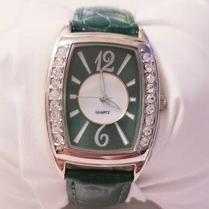 Quartz silver tone croc print green watch.